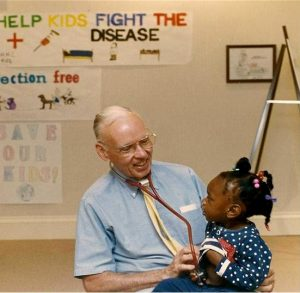 Dr. Jack McConnell with first patient | Volunteers in Medicine Clinic
